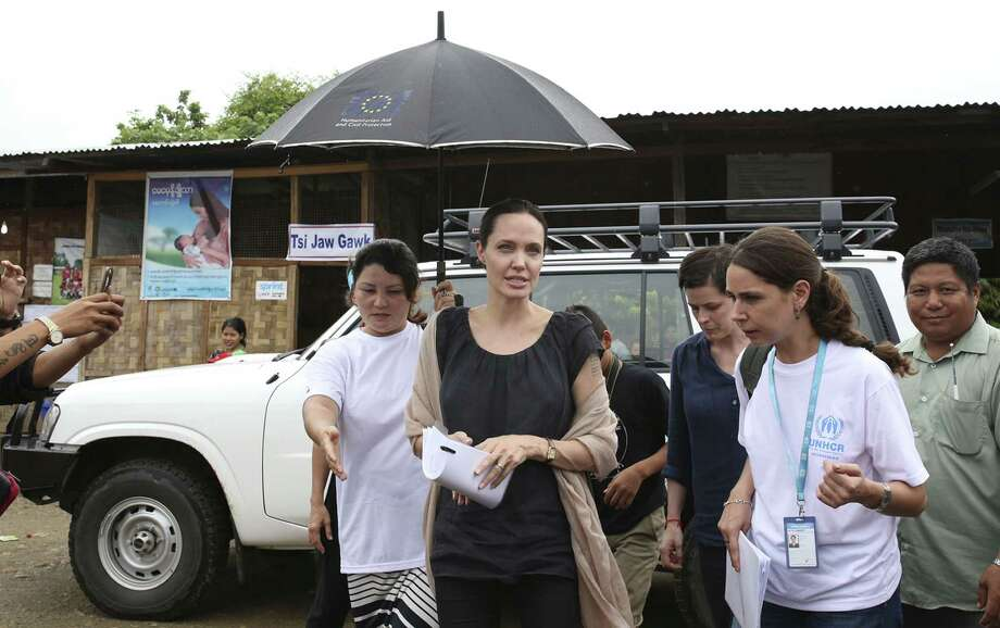 Actress Angelina Jolie Pitt, United Nations High Commissioner for Refugees, special envoy and co-founder of the Preventing Sexual Violence Initiative, visits Jan Mai Kaung refugee camp in Myitkyina, Kachin State, Myanmar, Thursday. The refugees have fled fighting between the Burmese government and the Kachin Independence Army since 2011. Photo: AP Photo/Hkun Lat / AP