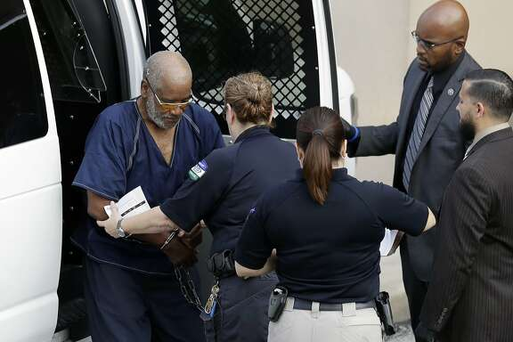 James Mathew Bradley Jr., 60, of Clearwater, Florida, left, arrives at the federal courthouse for a hearing, Monday, July 24, 2017, in San Antonio. Bradley was arrested in connection with the deaths of multiple people packed into a broiling tractor-trailer. (AP Photo/Eric Gay)
