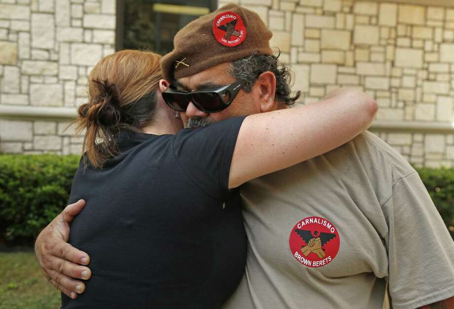 Henry San Miguel with the Texas Brown Berets gives Amy Vilela of Healthcare Now a hug. Both were in attendance at a press conference announcing the Millions Marching for Medicare for All march scheduled for July 29. The news conference was near Metropolitan Methodist Hospital on July 24, 2017. Both parents lost a child due to what they fell was inadequate health coverage. Photo: Ron Cortes /For The San Antonio Express-News / Freelance