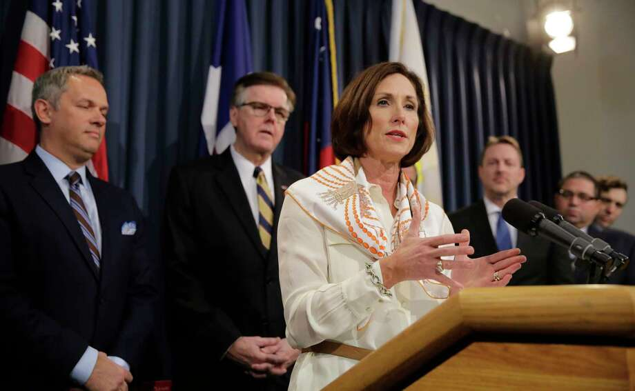 FILE - In this March 6, 2017, file photo, Texas Sen. Lois Kolkhorst, front, backed by Texas Lt. Gov. Dan Patrick, center, and other legislators talks to the media during a news conference to discuss Senate Bill 6 at the Texas Capitol in Austin, Texas. Just months after a high-profile study revealed that Texas has one of the highest maternal mortality rates in the developed world, state lawmakers failed to respond by passing comprehensive legislation to combat the crisis during the legislative session. (AP Photo/Eric Gay, File) Photo: Eric Gay, STF / Copyright 2017 The Associated Press. All rights reserved.