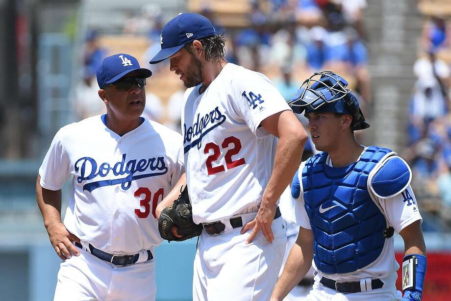 Clayton Kershaw was removed from Sunday's game after two innings. He has a lower back strain. Photo: Lisa Blumenfeld, Getty Images