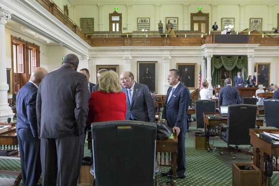 Senators gather around Finance Committee Chair Jane Nelson on Monday, the seventh day of a special session, at the Texas Capitol in Austin.