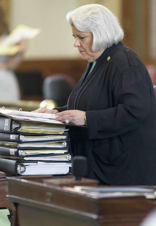 State Sen. Judith Zaffirini, D-Laredo, works at her desk on the Senate floor during the early days of the special session. Sunday night, she logged her 60,000th vote in a row, drawing applause and congratulations from Lt. Gov. Dan Patrick and her colleagues. Photo: Stephen Spillman /For The Express-News / stephenspillman@me.com Stephen Spillman