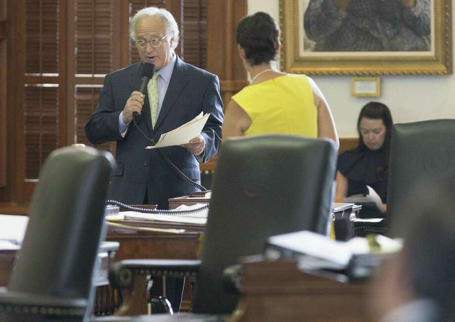 State Sen. Kirk Watson, Austin, speaks with State Sen. Donna Campbell, New Braunfels, on the Senate floor during the seventh day of a special session at the Texas Capitol last year. Watson has pledged to help fix Texas public records law in the next session. Photo: Stephen Spillman /Stephen Spillman / stephenspillman@me.com Stephen Spillman