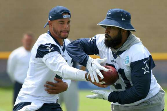 The spotlight is on Cowboys quarterback Dak Prescott, left, and running back Ezekiel Elliott as they begin season No. 2