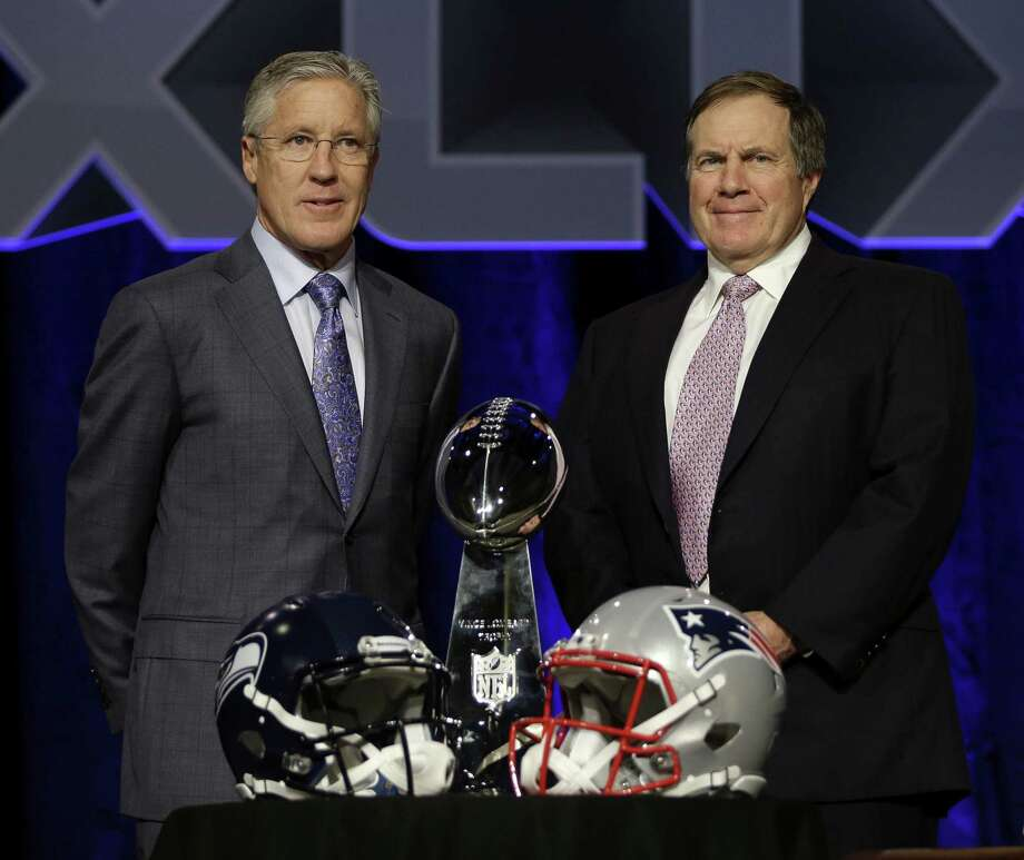 Seattle Seahawks coach Pete Carroll, left, and New England Patriots coach Bill Belichick will face each other on Sunday in Super Bowl XLIX in Phoenix. Photo: David J. Phillip — The Associated Press   / AP