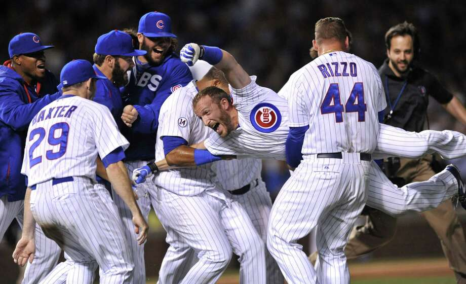 Southington native Chris Denorfia is carried by his Chicago Cubs teammates after hitting the game-winning sacrifice fly ball to score Matt Szcur during the 10th inning to defeat the Los Angeles Dodgers 1-0 on June 23. Photo: Paul Beaty  — The Associated Press   / FR36811 AP