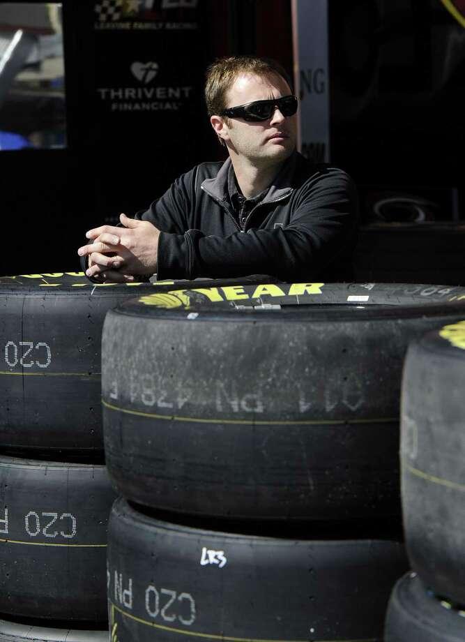 NASCAR driver Travis Kvapil waits in the garage Friday at Atlanta Motor Speedway. Photo: John Amis — The Associated Press   / FRE69715 AP