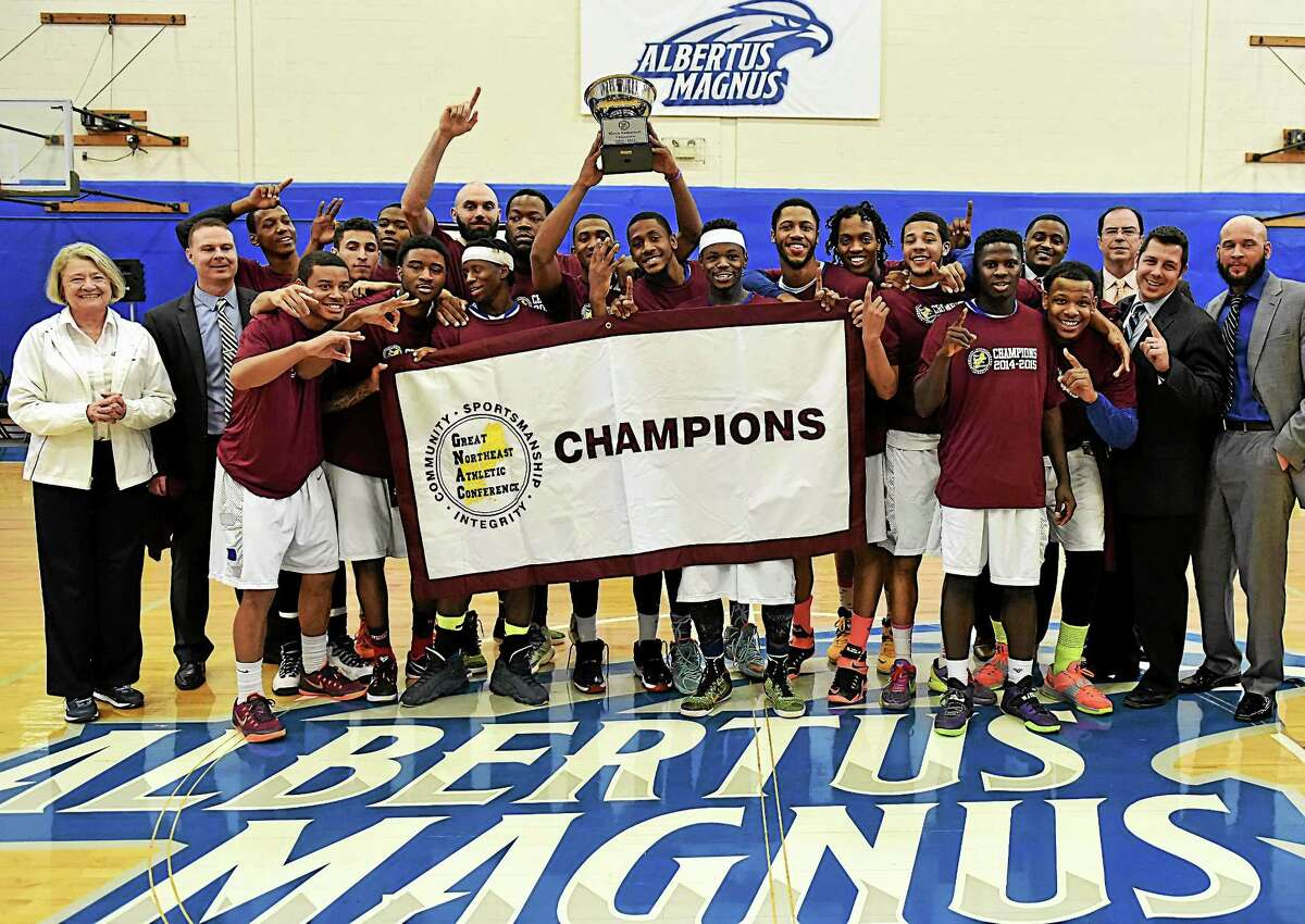 The Albertus Magnus men's basketball team celebrates its Great Northeast Athletic Conference tournament championship on Saturday.