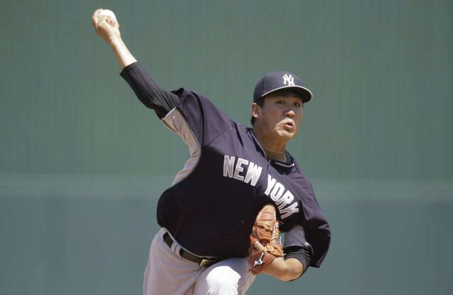 New York Yankees starter Masahiro Tanaka delivers against the Minnesota Twins on Tuesday in Fort Myers, Fla. Photo: Brynn Anderson — The Associated Press   / AP