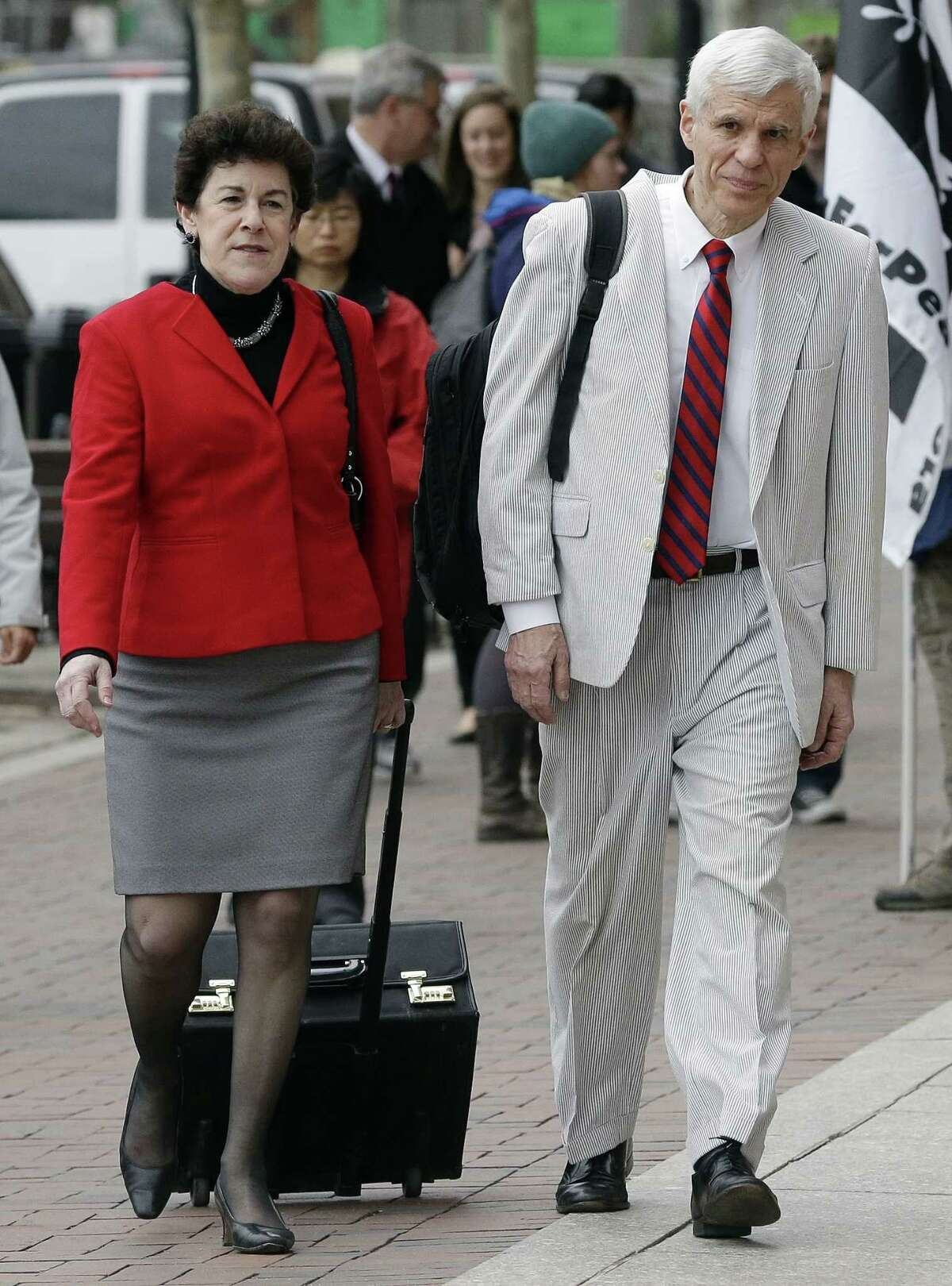 Defense attorneys Miriam Conrad, left, and David Bruck arrive at federal court in Boston Thursday, April 30, 2015, during the penalty phase in the trial of Dzhokhar Tsarnaev. Tsarnaev was convicted of the Boston Marathon bombings that killed three and injured 260 people in April 2013. (AP Photo/Steven Senne)