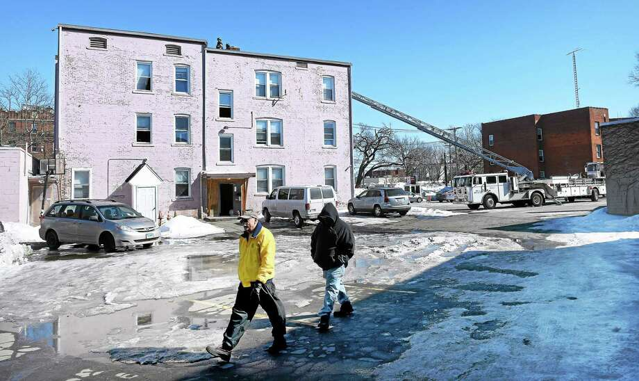 Firefighters respond to a fire at 690 Howard Ave. in New Haven Saturday. Photo: Arnold Gold — New Haven Register
