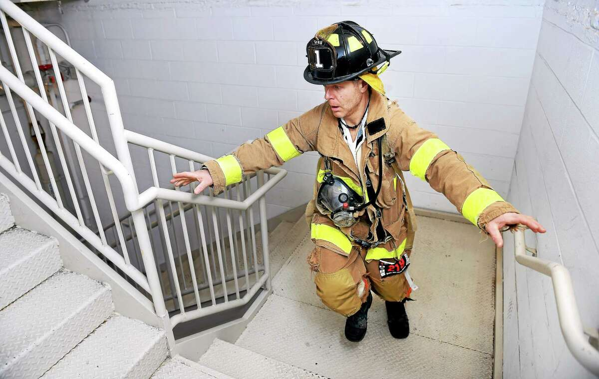Alan Hagander of the Stamford Fire Department begins the Firefighter Challenge at the Fight for Air Climb Saturday.