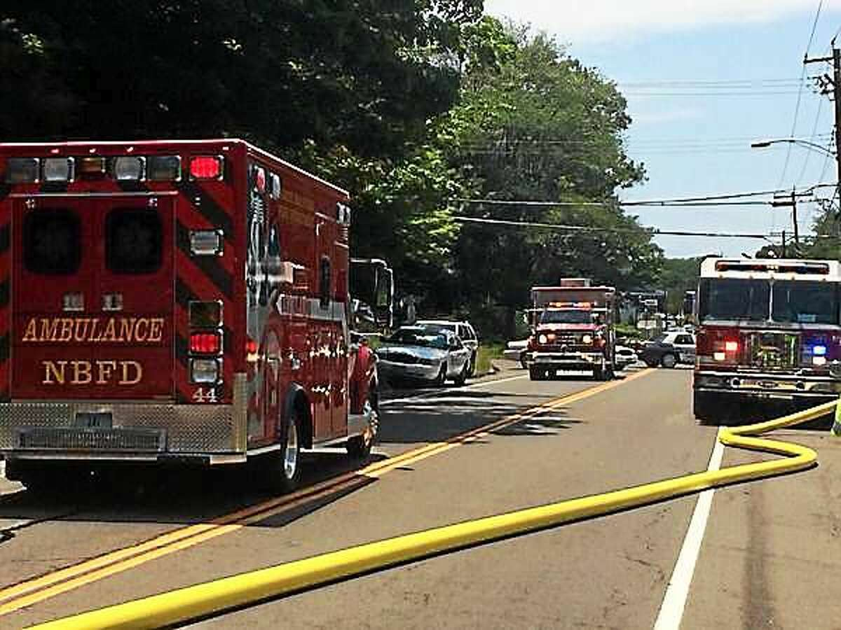 Route 80 was closed briefly Tuesday as fire crews responded to a house fire in North Branford.