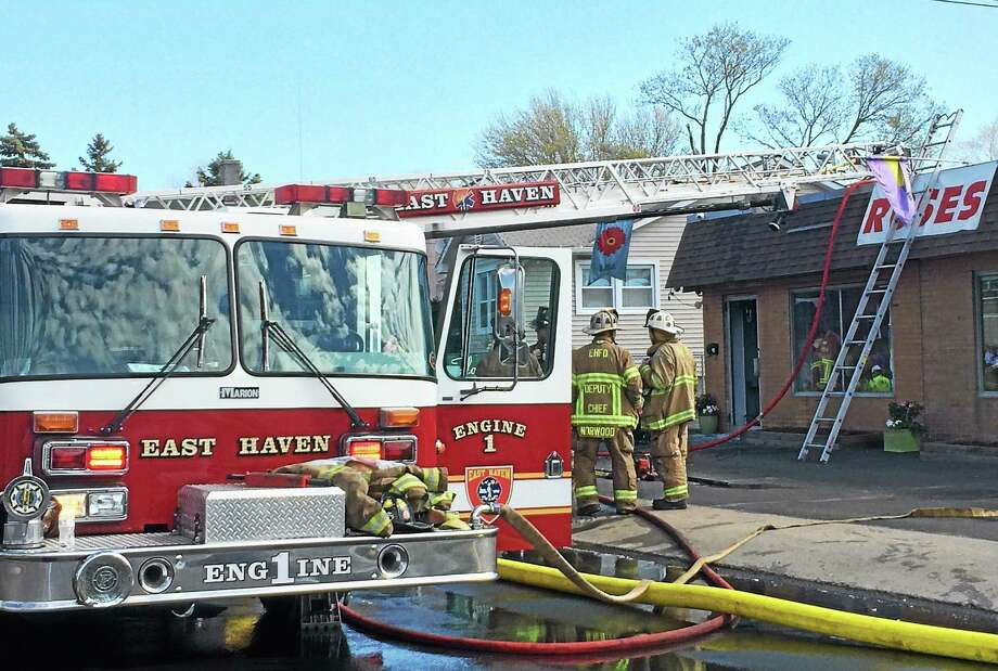 A fire broke out behind Flowers by Lisa, 33 Hemingway Ave., late Thursday morning, damaging the shop and shutting down the road for about an hour. Photo: (Wes Duplantier -- New Haven Register)