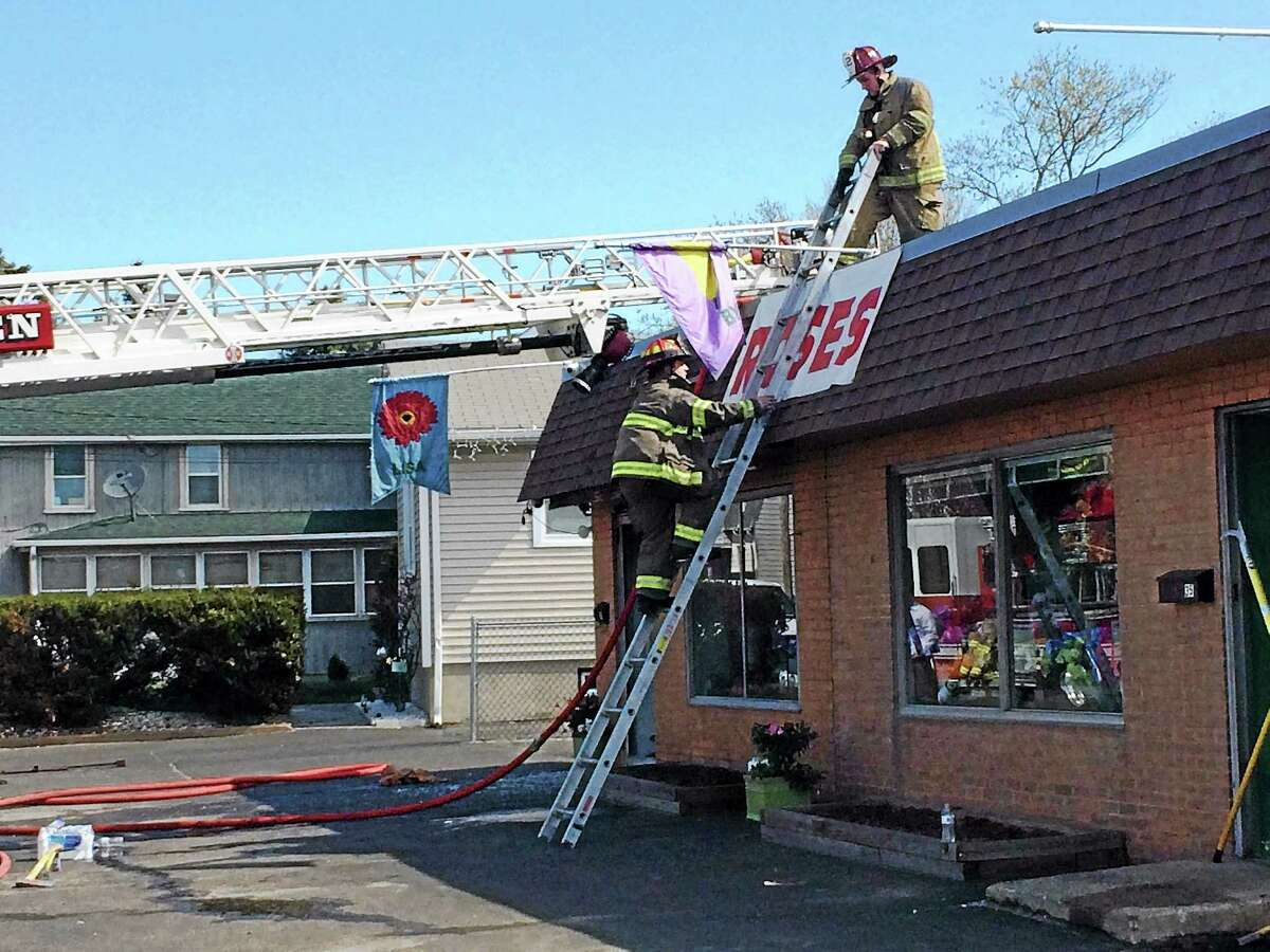 A fire broke out behind Flowers by Lisa, 33 Hemingway Ave., late Thursday morning, damaging the shop and shutting down the road for about an hour.