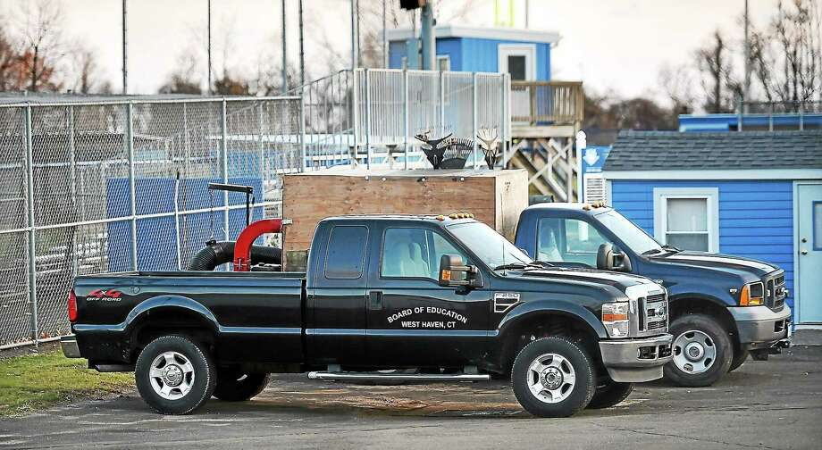 """(Catherine Avalone - New Haven Register)   (Catherine Avalone - New Haven Register)   A Ford F250 4x4 Off-Road pickup truck that the West Haven Board of Education bought with Carl D. Perkins technology grant funds was parked Friday behind a locked gate at West Haven High School's Ken Strong Stadium following the retirement of longtime shop teacher Garrett """"Gary"""" Grant. Grant retired as the state Department of Education was conducting an audit of the district's Perkins grant administration. The audit reportedly includes the use of the pickup. Photo: Journal Register Co. / New Haven RegisterThe Middletown Press"""