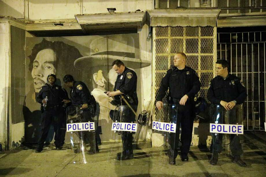 Police prepare ahead of a 10 p.m. curfew Wednesday, April 29, 2015, in Baltimore. The curfew was imposed after unrest in Baltimore over the death of Freddie Gray while in police custody. (AP Photo/Matt Rourke) Photo: AP / AP