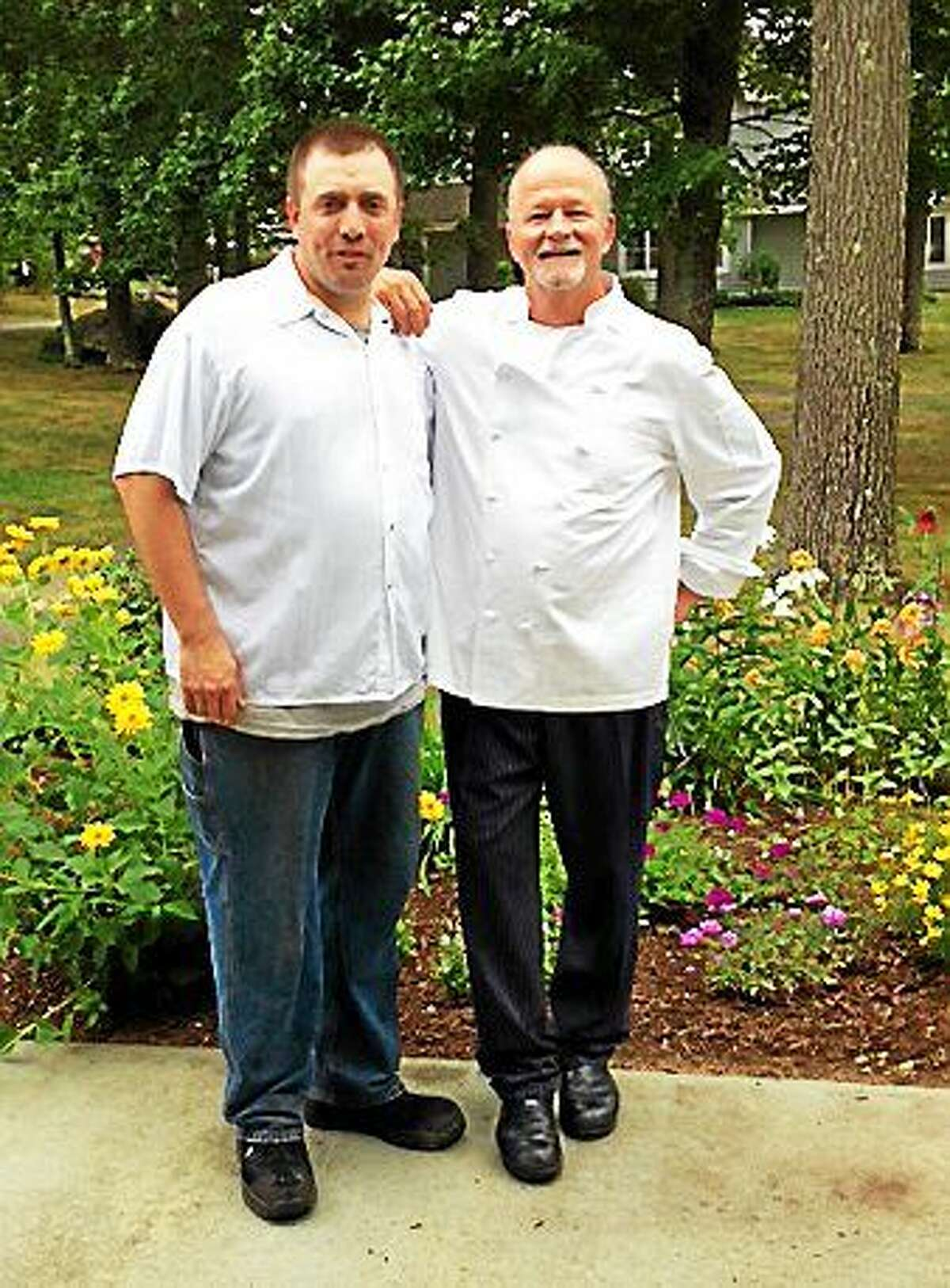 CONTRIBUTED PHOTO Pictured: Vista member Gordon Ewen, left, and Food Service Director Chris Pardue.