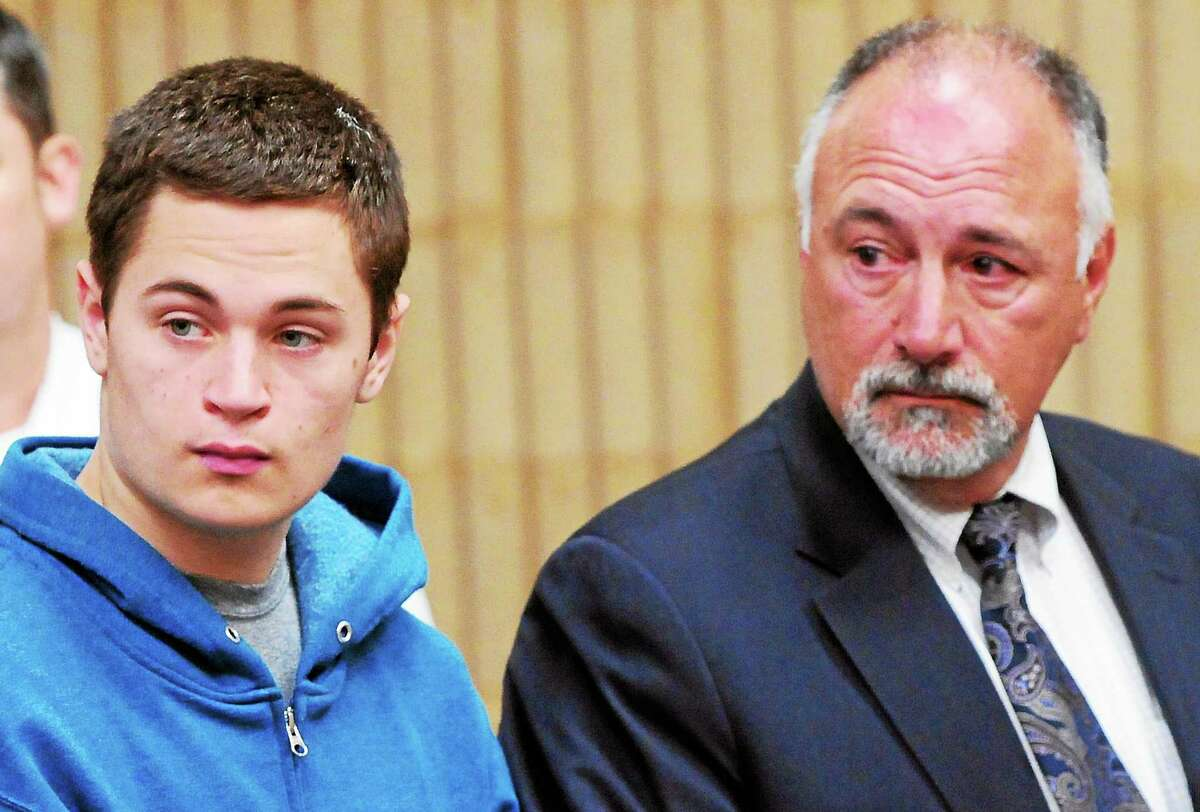 Christopher Michael Plaskon appears in Superior Court in Milford in May. Defense attorney Richard T. Meehan Jr. is at right.