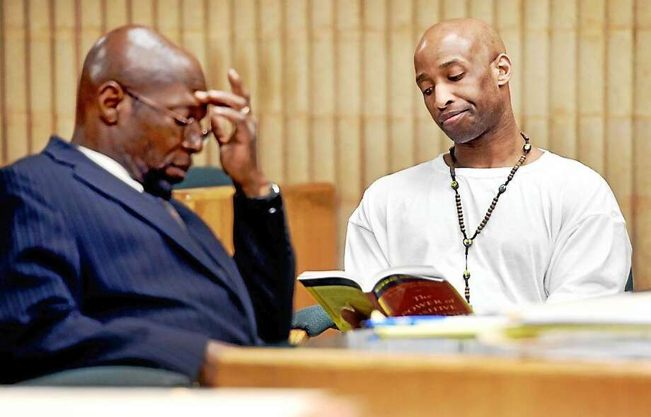 Matthew Pugh reads during his sentencing in May. Photo: Arnold Gold — New Haven Register