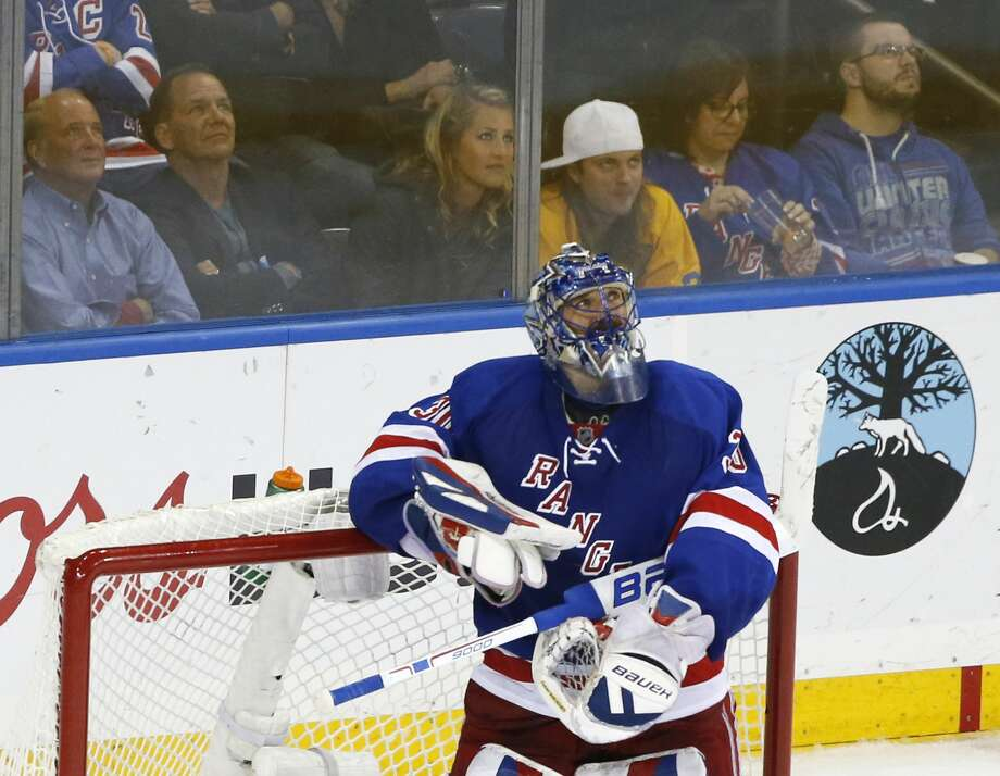 Goalie Henrik Lundqvist and the New York Rangers were eliminated from the Stanley Cup Playoffs on Friday. Register columnist Chip Malafronte says that Lundqvist, who is the closest thing hockey has to Mariano Rivera, could have used a little more support from his teammates in the final period of Game 7 against the Lightning. Photo: Kathy Willens — The Associated Press   / AP