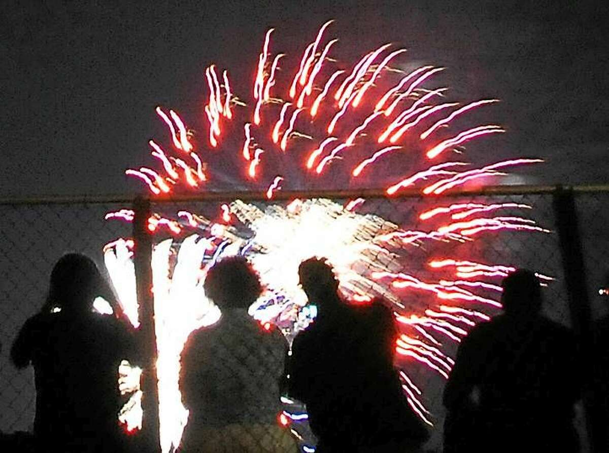 Spectators watch the fireworks from the Wilbur Cross High School football field at a previous Fourth celebration.