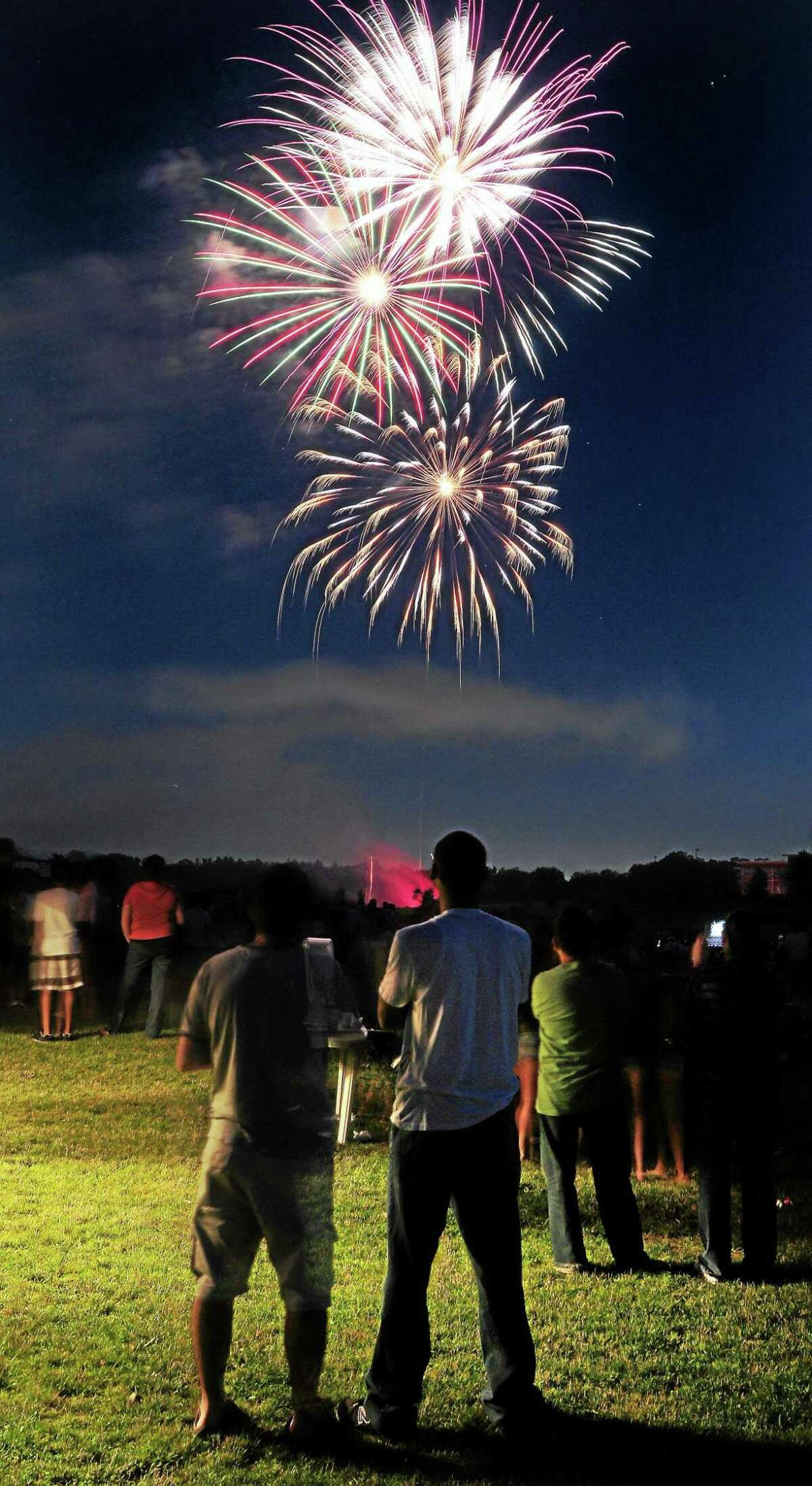 People watch the fireworks show at Town Center Park at Meadowbrook in Hamden on 7/1/2011. Photo by Arnold Gold/New Haven Register AG0417D