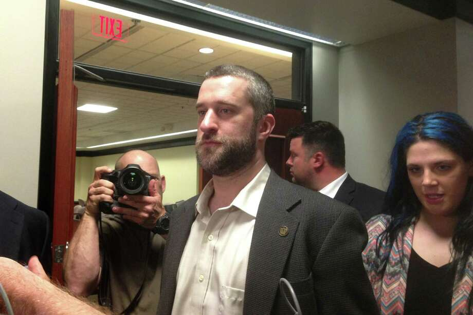 "Television actor Dustin Diamond, center, exits the courtroom in Port Washington, Wis., Friday night, May 29, 2015, after a 12-person jury convicted him of two misdemeanors stemming from a barroom fight, but a Wisconsin jury cleared the former ""Saved by the Bell"" actor of the most serious felony charge. (AP Photo/Dana Ferguson) Photo: AP / ap"