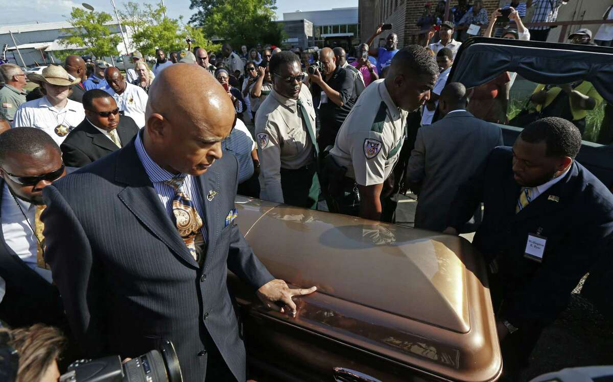 The casket bearing the body of blues legend B.B. King is wheeled to a waiting hearse in front of the B.B. King Museum and Delta Interpretive Center after a day of public viewing, Friday, May 29, 2015 in Indianola, Miss. The visitation comes a day before the funeral for the man who influenced generations of singers and guitarists. (AP Photo/Rogelio V. Solis)