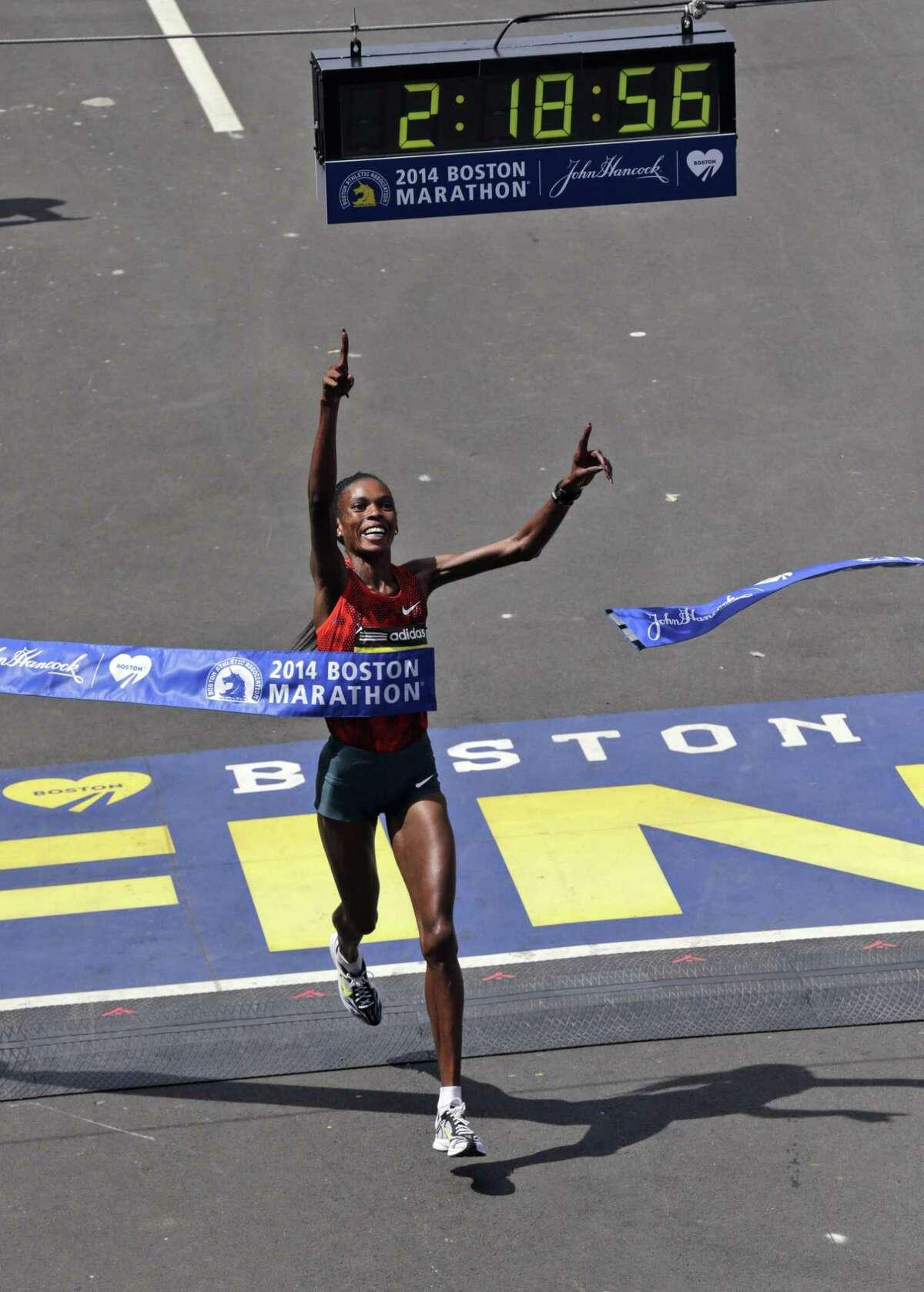 In this April 21, 2014 file photo, Rita Jeptoo of Kenya breaks the tape to win the 118th Boston Marathon.
