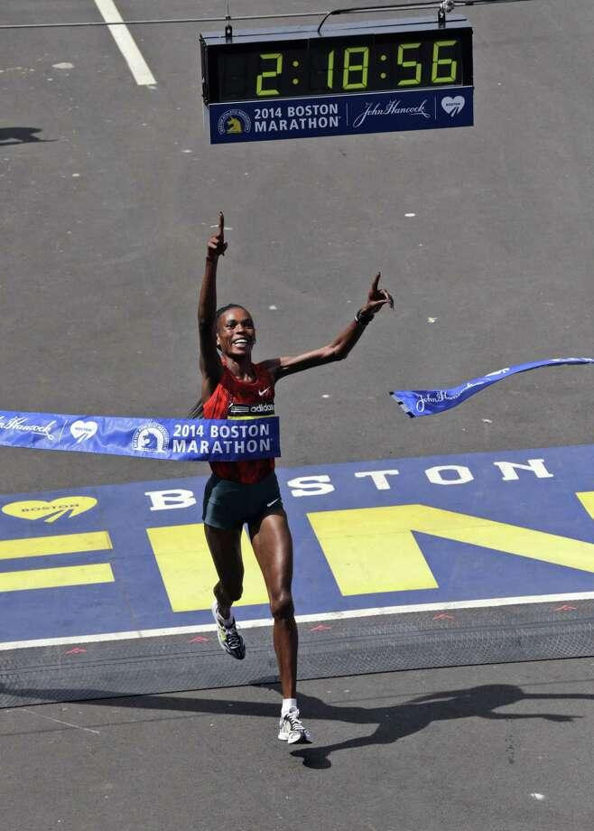 In this April 21, 2014 file photo, Rita Jeptoo of Kenya breaks the tape to win the 118th Boston Marathon. Photo: Charles Krupa — The Associated Press File Photo   / AP