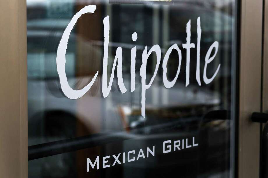 This Tuesday, Jan. 28, file photo shows the door of a Chipotle Mexican Grill in Robinson Township, Pa. Chipotle on April 27 said it has completed phasing out genetically modified ingredients from its food, making it the first national fast-food chain to do so. Photo: AP Photo   / AP