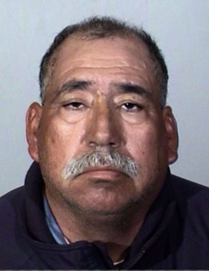 This Tuesday, Feb. 24, 2015 booking photo provided by the Oxnard Police Department shows Jose Alejandro Sanchez-Ramirez, 54, of Yuma, Arizona, who was the driver of a pickup truck that a Southern California commuter train smashed into on Tuesday, Feb. 24, 2015. He was found about a half-mile away from the crash 45 minutes later, said Jason Benites, an assistant chief of the Oxnard Police Department.  Sanchez-Ramirez was briefly hospitalized before being arrested Tuesday afternoon on suspicion of felony hit-and-run. (AP Photo/Oxnard Police Department) Photo: AP / Oxnard Police Department