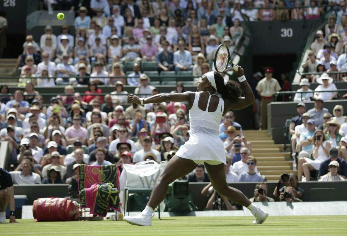 Serena Williams returns a ball to Margarita Gasparyan during their first-round match at Wimbledon on Monday.