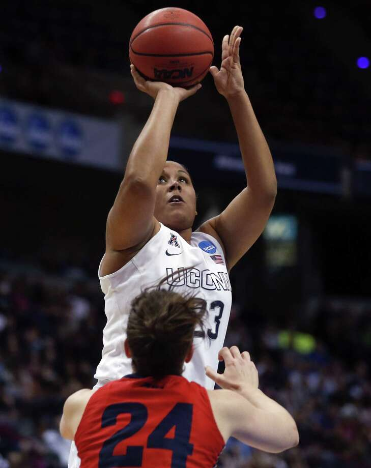 Connecticut forward Kaleena Mosqueda-Lewis (23) shoots over Dayton guard Andrea Hoover (24) during the first half of a regional final game in the NCAA women's college basketball tournament Monday, March 30, 2015, in Albany, N.Y. (AP Photo/Mike Groll) Photo: AP / AP