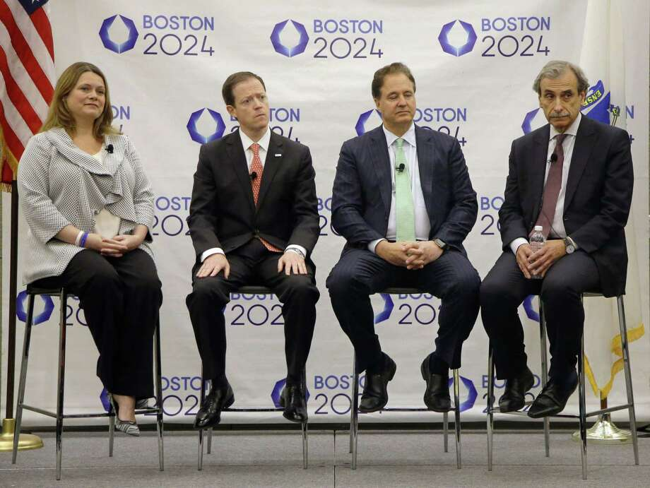 From left, Boston 2024 Partnership Chief Operating Officer Erin Murphy, Chief Executive Office Rich Davey, Chairman and Boston Celtics co-owner Steve Pagliuca and architect David Manfredi listen to a reporter's question during a media availability after they released the updated plans for the Olympic and Paralympic games at the Boston Convention and Exhibition Center on Monday. Photo: The Associated Press   / AP