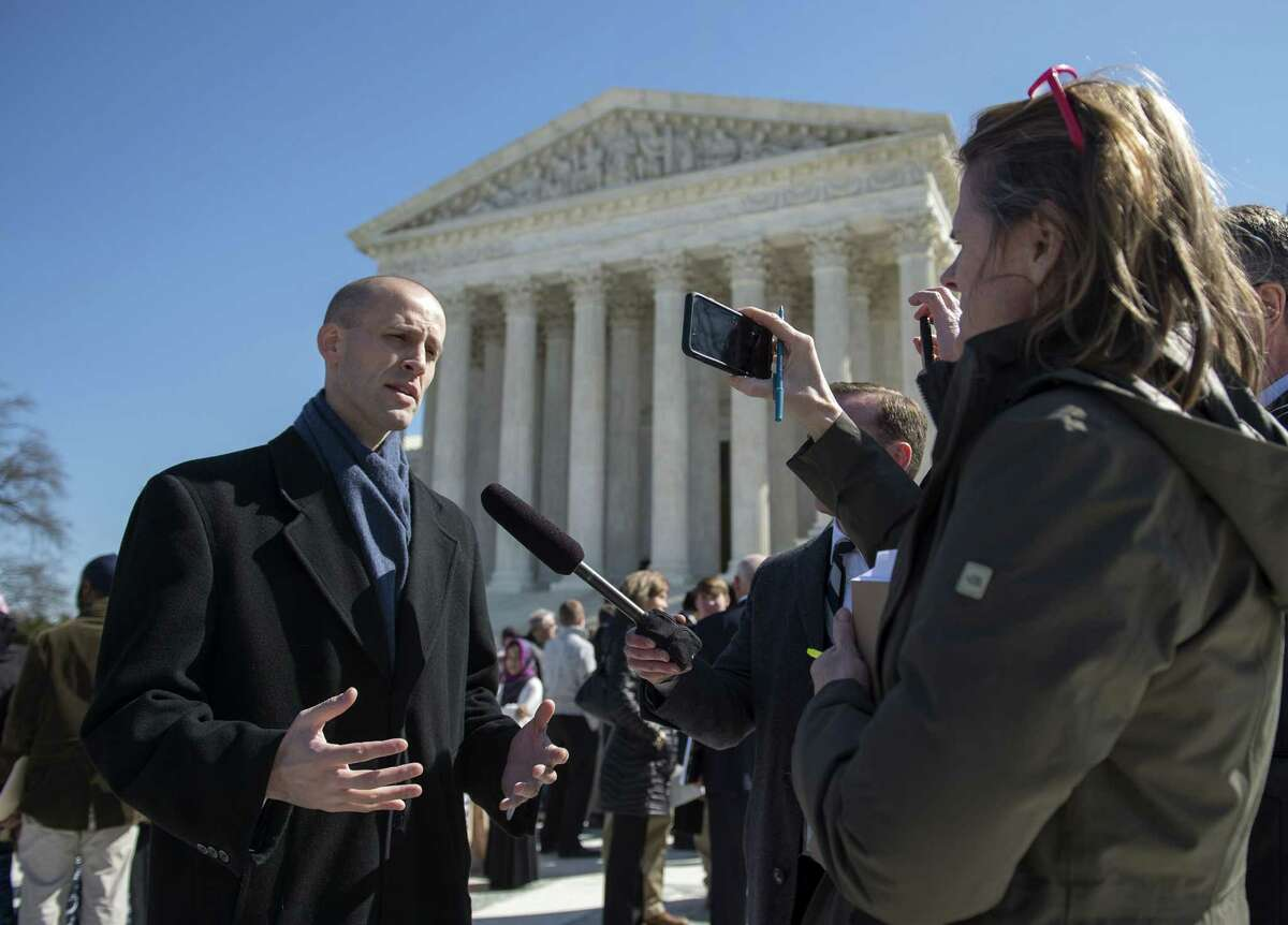 Texas Solicitor General Scott Keller, attorney for petitioners, speaks to reporters outside the Supreme Court in Washington on March 23 after the court heard arguments in Walker v. Sons of Confederate Vets case.