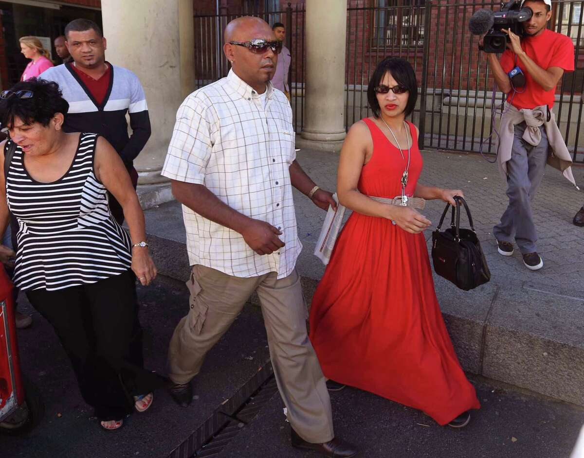 Celeste Nurse, right, the mother of a girl that was kidnapped as a baby 17 years ago, leaves the court after attending the appearance of a woman suspected of the kidnapping in Cape Town, South Africa, Friday, Feb. 27, 2015. South African police say a girl who was kidnapped as a baby 17 years ago, has been returned to her family. Police spokesman Andre Traut said that a 50-year-old woman was arrested and appeared in court on Friday morning in connection with the kidnapping. (AP Photo)