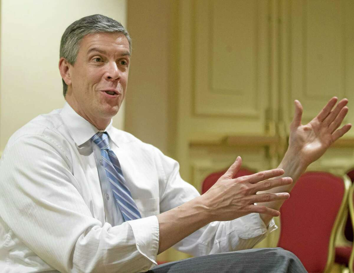 In this Jan. 17, 2013, file photo, Education Secretary Arne Duncan gestures as speaks to the Associated Press during an interview in Washington related to No Child Left Behind. States can request permission to ignore parts of the No Child Left Behind education law through the spring of 2016, the Education Department has said.