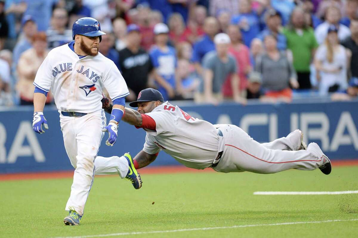 Toronto Blue Jays' Russell Martin, left, is chased down and tagged out by Red Sox third baseman Pablo Sandoval in the second inning Monday.