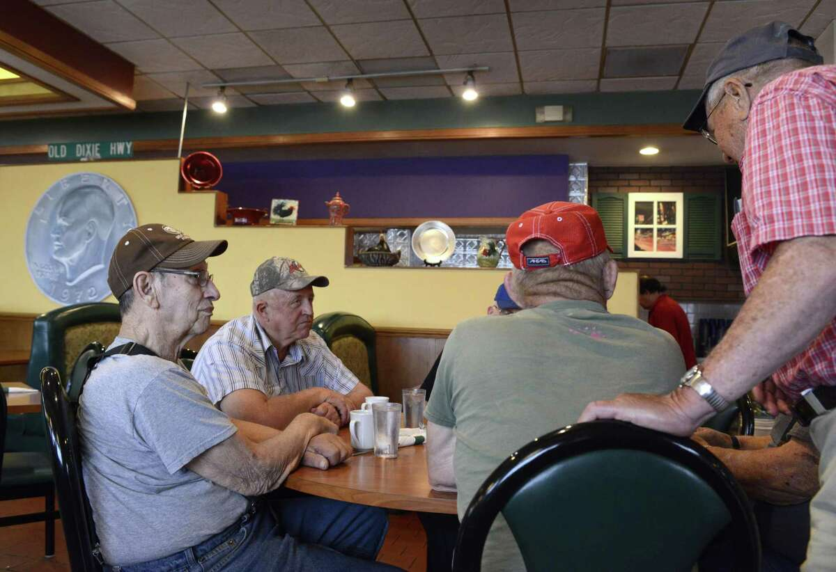 Diners at the silver dollars restaurant talk about former Speaker of the House Dennis Hastert in his hometown of Yorkville, Illinois, Saturday, May 30, 2015.