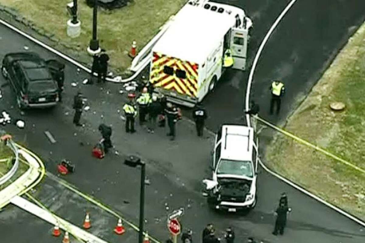 In this image made from video and released by WJLA-TV, authorities investigate the scene of an accident near a gate to Fort Meade, Md. on Monday.