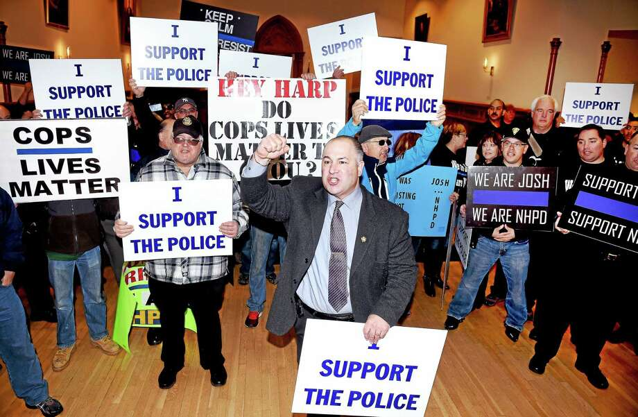 New Haven Police Union President Louis Cavaliere, Jr., (center) leads a pro-police rally into City Hall in New Haven interrupting a press conference announcing the exoneration of New Haven Police Officer Joshua Smereczynsky in March. Photo: Arnold Gold--New Haven Register