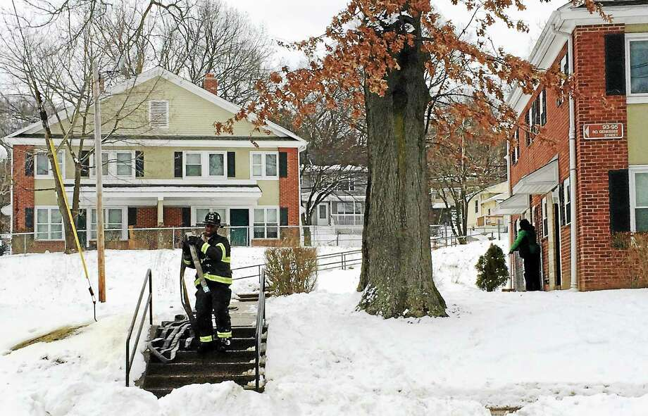 A woman was displaced from her home in the McConaughy Terrace public housing complex Friday afternoon after a kitchen fire. She was not hurt but the unit was damaged. Photo: Wes Duplantier — New Haven Register)