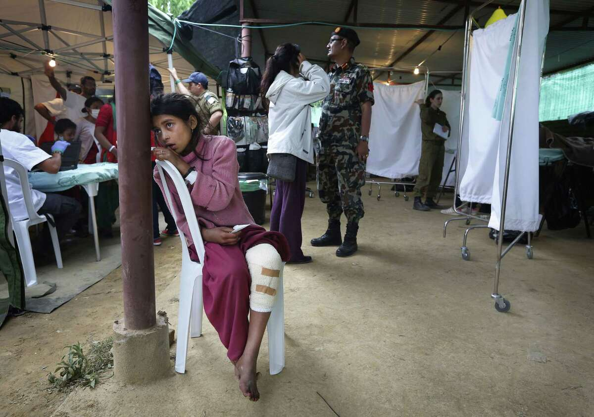 An Earthquake-affected Nepalese girl waits for treatment after receiving local first-aid elsewhere, at the Israeli field hospital for earthquake victims in Kathmandu, Nepal, Wednesday, April 29, 2015. Saturdayís disaster killed thousands and also injured many more, police said. The U.N. says the disaster has affected 8.1 million people, more than a fourth of Nepal's population of 27.8 million, and that 1.4 million needed food assistance. (AP Photo/Manish Swarup)