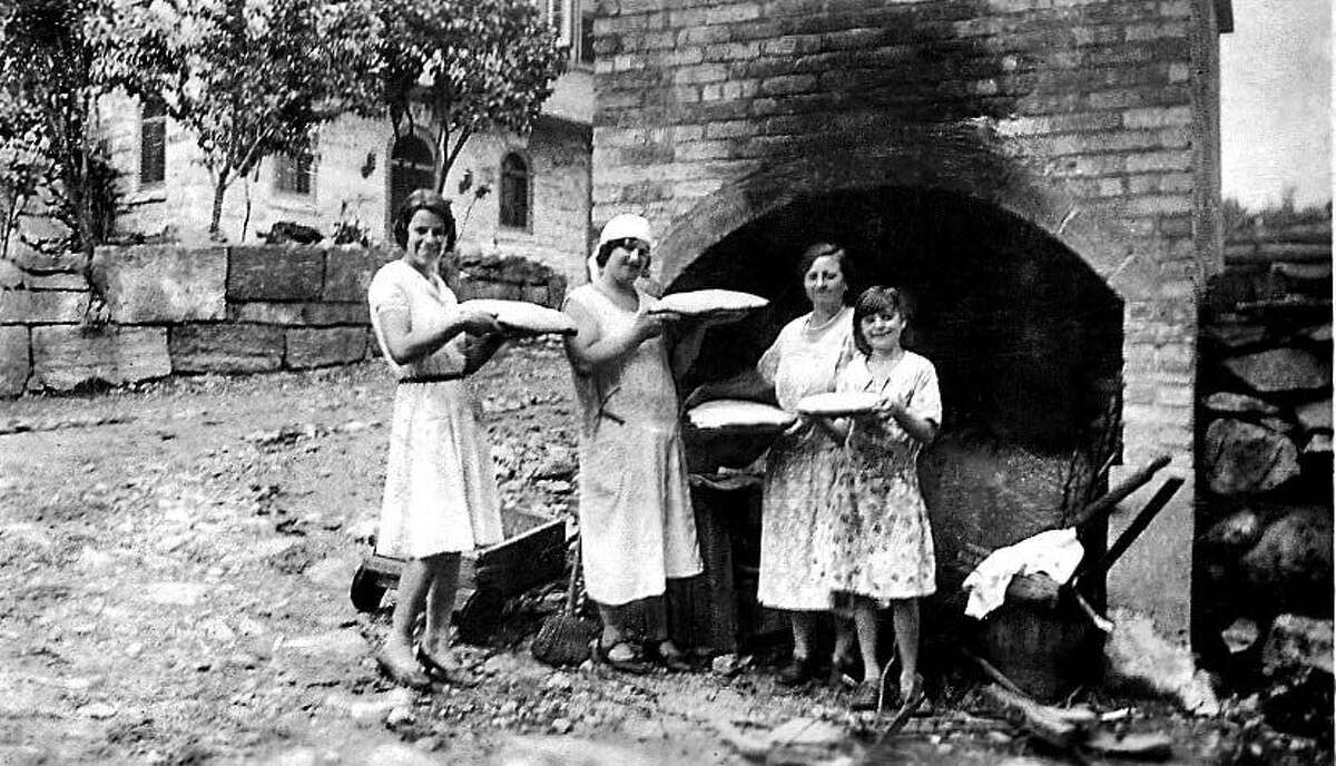 The women in the Becce family baking bread.