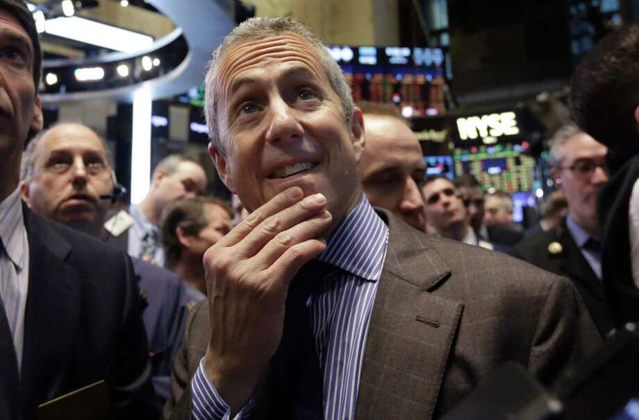 Danny Meyer, center, founder and CEO of Union Square Hospitality Group, waits for the Shake Shack IPO to begin trading, on the floor of the New York Stock Exchange Friday. Photo: Richard Drew — The Associated Press   / AP