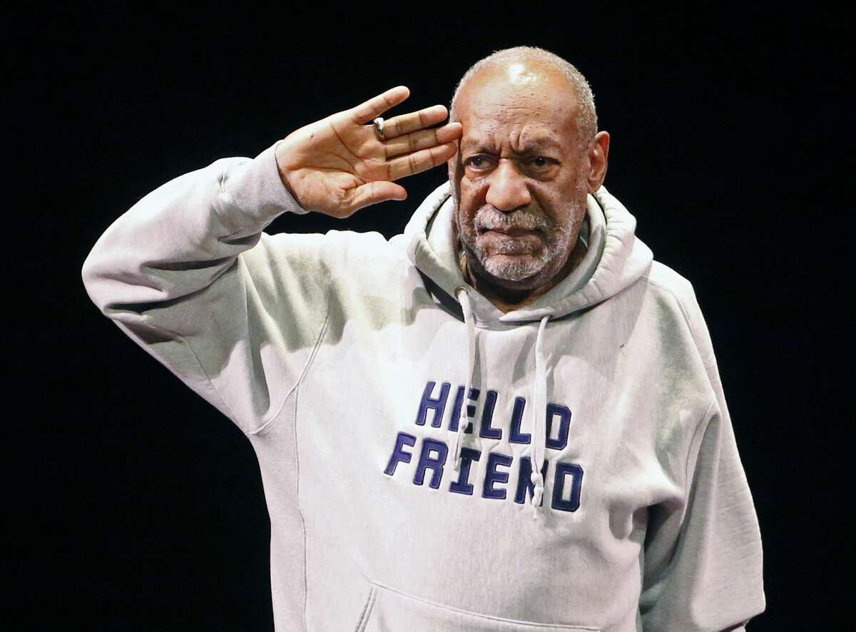 Bill Cosby salutes the crowd as he begins a performance at the Buell Theater in Denver. Cosbyís lawyers asked a federal judge on Friday, Feb. 27, to throw out a defamation lawsuit filed by three women accusing the comedian of decades-old sexual offenses. (AP Photo/Brennan Linsley, File)