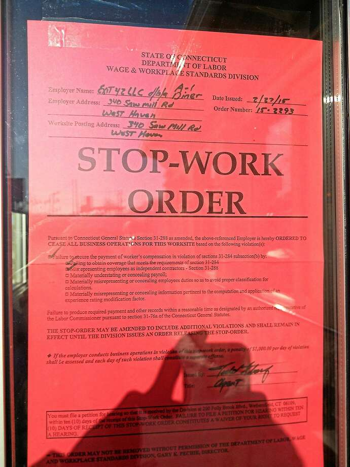 A stop-work order is seen on the glass of A-1 Diner in West Haven Friday. Photo: Esteban L. Hernandez — New Haven Register
